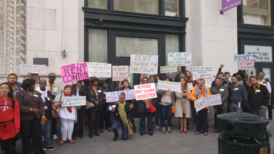 Midtown tenants and their allies, including Boalt Hall law students and Mission tenants' rights advocates Chirag Bhakta, Andy Blue and Erick Arguello, gather for the Sept. 19 rent control rally outside the Rent Board at Market and Van Ness.