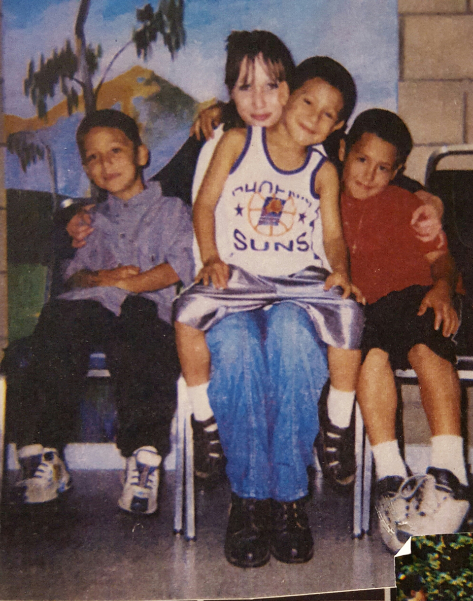 Misty Rojo, in this treasured 12-year-old photo, gets a visit from three of her four sons while she was incarcerated. It would be four more years before she saw them again. Now she's out and a leader in the struggle for justice, and her boys are just about grown – one starting college this year.