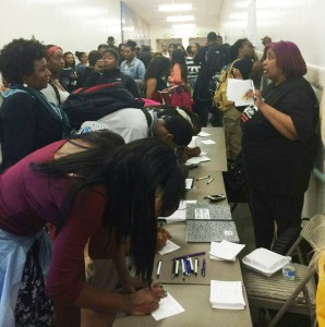Students crowd around the registration table at last year's fair.