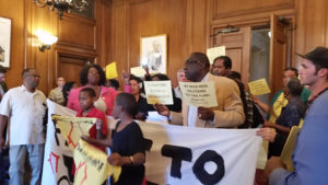 Crowding into Room 200, the office of Mayor Ed Lee, on Oct. 20, Bayview Hunters Point residents, their faces reflecting their determination to fight to stay in San Francisco, demand a real housing plan to allow them to afford to live in the community they love. Many have roots as deep as five generations. – Photo: ACCE