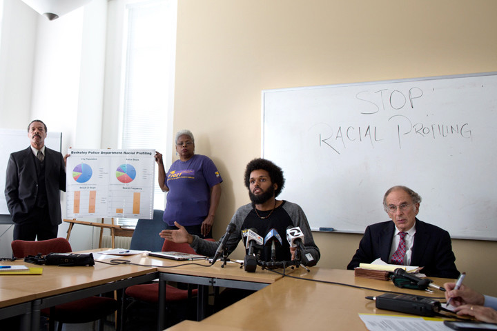 "Mansour Id-Deen of the Berkeley NAACP, left, with representatives of Berkeley Copwatch and the UC Berkeley Black Student Union present racial profiling data to the Berkeley Police Department on Sept. 29, 2015. The three, part of a coalition that also includes the National Lawyers Guild, the Peace and Justice Commission and the ACLU, analyzed nearly seven months of data on about 4,700 traffic stops, finding that 30.5 percent involved Black motorists, whereas the Black population, according to Id-Deen, is close to 5 percent. Berkeleyside reports, ""Id-Deen said the coalition believes the traffic stop data is evidence of 'illegal patterns and practices by some members of the Berkeley Police Department' that give weight to concerns expressed by people of color 'for a very, very long time here in Berkeley' about racial profiling and over-policing."" – Photo: Emilie Raguso, Berkeleyside"