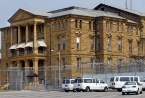 This is the grim façade of the Menard Correctional Center, built in 1878, Illinois' second oldest prison, on the banks of the Mississippi River in Chester, Ill. – Photo: The Southern