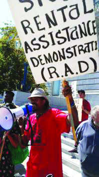 POOR organized this rally against public housing privatization way back on Sept. 24, 2013, alerting most San Franciscans for the first time to the evil scheme called RAD. The speaker is poverty skola Ayat-Jalal Bryant. – Photo: Poor News Network
