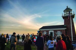 A rally to end solitary confinement at the lighthouse in Santa Cruz closes at sunset with a moment of silence on March 23, 2015.