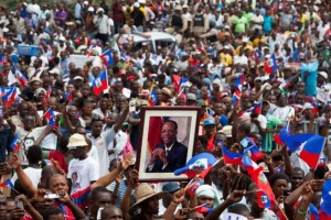 "A massive crowd cheered the Sept. 30 speech by former President Dr. Jean-Bertrand Aristide outside his home, breaking a four year silence. He urged his people not to be bought by the big money trying to defeat Lavalas, saying Haiti means ""Do not obey!"" and that the issue ""is not money, it is dignity."""
