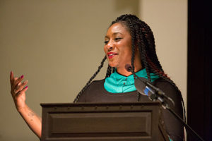 """Eight hundred people filled Harvard's Memorial Church on Oct. 30, 2015, when Alicia Garza, Oakland-based co-founder of the Black Lives Matter network, was the honoree of the ninth annual Robert Coles """"Call of Service"""" Lecture and Award. She began by dedicating the award to the BLM network and the people """"still fighting for humanity and dignity."""" When she coined the phrase Black Lives Matter in 2013, she called it """"a love letter to our people"""" and """"a call to action."""" – Photo: Jon Chase, Harvard staff photographer"""