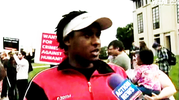 Claude Gatebuke leads a protest against an appearance by Rwandan President Paul Kagame at Carnegie Mellon University on Sept. 16, 2011. He is being interviewed by WTAE TV-Pittsburgh.