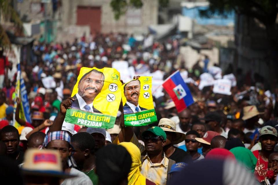 Protesters hold up election posters promoting presidential candidate Jude Celestin of the Lapeh party during a protest against official preliminary election results, in Port-au-Prince, Haiti, on Nov. 11. Haitian political parties Lavalas, Lapeh and Platform Pitit Dessalines have joined to demand the cancellation of the recent presidential election or removal of ruling party candidate Jovenel Moise, who is set to face Celestin in the Dec. 27 presidential runoff election. – Photo: Dieu Nalio Chery, AP