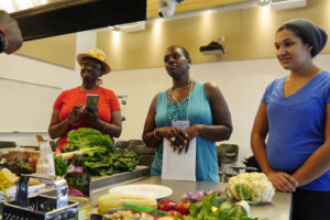 Black farmers proudly display their produce and show how to make a feast of it. – Photo: Fatima Nasiyr