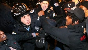 On Nov. 24, protesters demonstrate their rage at Chicago police after the release of the 2014 video of Laquan McDonald being shot by Officer Jason Van Dyke near Michigan Avenue. – Photo: Nuccio DiNuzzo, Chicago Tribune