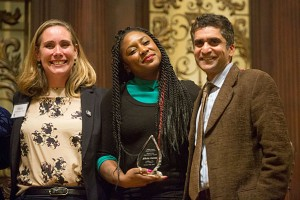 """Alicia Garza poses with Maria Dominguez Gray, Phillips Brooks House Association's executive director, and Harvard College Dean Rakesh Khurana, who presented her with the """"Call of Service"""" Award. – Photo: Jon Chase, Harvard staff photographer"""