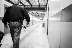 Pelican Bay gang investigator, now associate warden Capt. Dave Barneburg walks down a SHU corridor in 2013. He appeared as a witness in Jesse Perez's November 2015 trial against his guards. – Photo: Bryant Anderson, Del Norte Triplicate