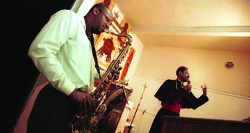 Archbishop Franzo King, pastor of the Coltrane Church, preaches to splendid musical accompaniment. – Photo: SF Chronicle