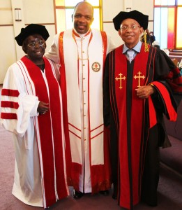 Espanola Jackson and Willie Ratcliff stand with their pastor, Bishop Ernest Jackson, after being awarded honorary doctoral degrees in humanities by the Sacramento Theological Seminary on Oct. 28, 2012. Seminary director Bishop McBride told the assemblage that the doctorate Martin Luther King used with pride was also an honorary degree. – Photo: Francisco Da Costa