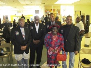 At the Carver Elementary School tribute to elders, Espanola is backed by Chester Williams, CEO of CKW Global Enterprises and public relations director of HP-UNITI; Randolph James, president of HP-UNITI; Charles Grays, United Fathers Coalition; and John Smith, member of HP-UNITI. – Photo: Lance Burton, Planet Fillmore Communications