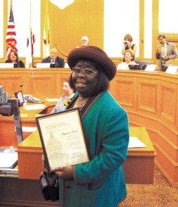On April 24, 2008, Espanola smiles after being presented with an award at City Hall from the Human Rights Commission.