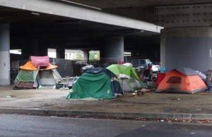A camp under the 880 freeway in downtown Oakland – Photo: Darwin Bond-Graham