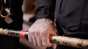 Sheriff's Deputy Borovina, one of an army of law enforcers who failed dismally to stop the disruption, grips his baton with a hand resplendent with gang tattoos. – Photo: Noé Serfaty