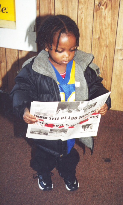 """Even very small children used to tag along with their older siblings to deliver the Bay View door to door in Bayview Hunters Point. Young adults often stop us to ask, """"Do you remember me? I used to carry the paper – and I've read it all my life."""" The paper in this photo has our pre-2003 masthead."""