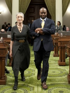 Assemblyman Tony Thurmond proudly escorts Betty Reid Soskin during the Black History Month Ceremony in the Assembly chambers in Sacramento.