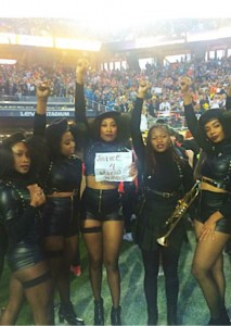 """Thanks to activists Ronnisha Johnson and Rheema Emy Calloway, some of Beyoncé's dancers took a moment to pose with a """"Justice 4 Mario Woods"""" sign, living the role of the Black Panthers that their costumes portray. Gwen Woods, the mother of Mario Woods, said, """"Beyoncé gave my son a global stage!"""" – Photo: Kofi Ademola Xola"""