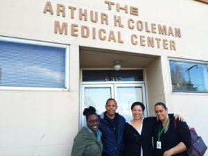 JayVon Muhammad, Nicole Johnson and Kiki Jordan of Marin City Health & Wellness Center and Robert Watkins of the City and County of San Francisco stand outside the new Bayview Hunters Point clinic location, the revered Coleman Medical Center.