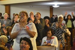 Spirits were high at the service. – Photo: Patricia Winston