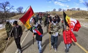 To the sounds of prayers, drumbeats and gunfire, hundreds of Native Americans marched Feb. 27, 2014, AIM Liberation Day, to pay homage to the 1973 occupation of Wounded Knee and demand freedom for Leonard Peltier.