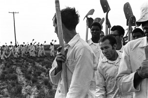 Prisoners trudge back to their cells after a long day's work on the Cummins Prison Farm in 1973. Most but not all Texas prisoners are Black, so organizing against prison slavery is a class struggle. – Photo courtesy The Marshall Project