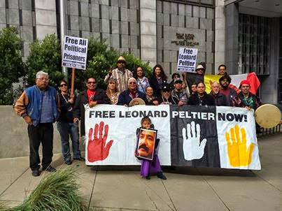 "A San Francisco rally on AIM Liberation Day, Feb. 27, 2014, called for a Department of Justice investigation into the 1973-1976 ""Reign of Terror"" on the Pine Ridge reservation and for freedom for Leonard Peltier."