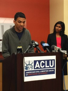"""Travis Hall, a 23-year-old college student who was brutally beaten by Officer Joshua Cabillo and two other SFPD officers """"just because I'm Black"""" on April 10, 2015, speaks to the press on Sept. 9, 2015, when the ACLU filed a lawsuit on his behalf. – Photo: Doug Sovern, Twitter"""