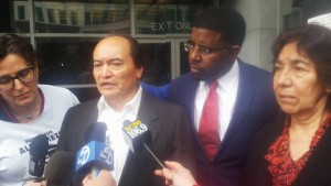 Refugio Nieto, Alex's father, speaks to the press. Beside him is the family's attorney, Adante Pointer. – Photo: Poor News Network