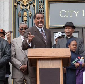 Black-Brown-Unity-to-End-Police-Impunity-rally-Min.-Christopher-Muhammad-speaks-City-Hall-031816-by-Pax-Ahimsa-Gethen-300x297, Black and Brown unity against police impunity, Local News & Views