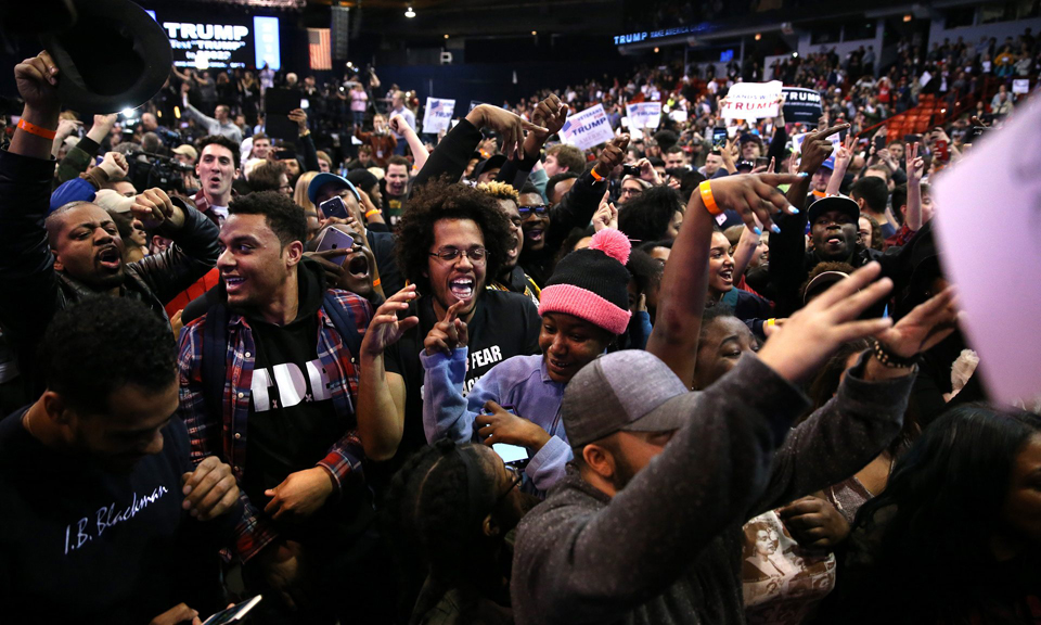 Students bent on shutting down the Chicago Trump campaign rally celebrate its cancellation. – Photo: Chicago Tribune