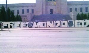 Free-Mondo-Ed-banner-Nebraska-State-Capitol-steps-031312-by-Mary-Ellen-Kennedy-300x180, Wopashitwe Mondo Eyen we Langa: A caged bird free at last, Behind Enemy Lines