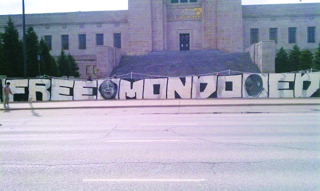 This enormous banner was displayed by Mondo and Ed's supporters on the steps of the Nebraska state capitol on March 13, 2012. – Photo: Mary Ellen Kennedy