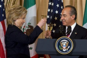 """Secretary of State Hillary Clinton and Mexican President Felipe Calderon toast during a luncheon in his honor at the State Department in Washington, Wednesday, May 19, 2010. The next day they traded barbs when Calderon criticized a new Arizona law requiring racial profiling. Clinton responded, """"You should take the log from your own eye before criticizing the speck in your neighbor's."""" – Photo: Cliff Owen, AP"""