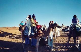 Sister Nida Ali rides a camel in Egypt in 2001.