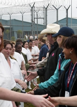 Women in a Gatesville, Texas, prison shake hands with volunteers from Operation Starting Line who held an Easter Outreach event there April 10-11, 2004. Editor's note: We also need photos of life in Texas' women's prisons. This is the only one I could find. A few stories and photos report on county jails in Texas, which we know are bad after what happened to Sandra Bland. The prisons must be worse.