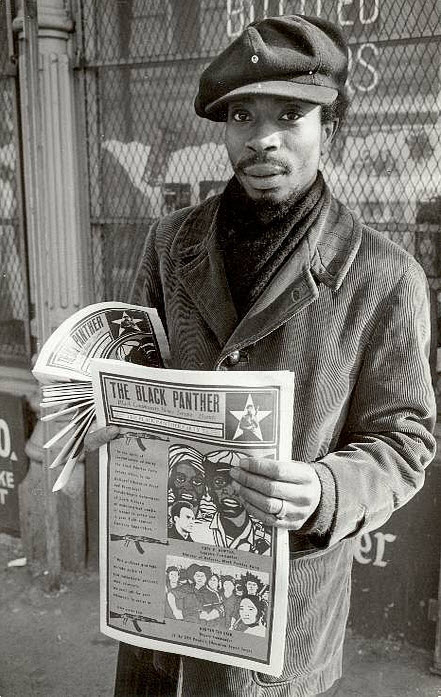 A young Panther sells The Black Panther newspaper in Boston. Note the powerful art by Emory Douglas on the front page. Every week, 250,000 copies were distributed around the country. – Photo: Stephen Shames