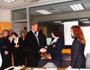 Bill and Hillary Clinton visit the State Department on April 11, 1994, four days after the Rwanda Genocide began. Former Ambassador Prudence Bushnell is at left, speaking with Hillary. April 11 was the day all U.S. government and foreign personnel had been successfully evacuated from Rwanda. – Photo from the personal collection of Prudence Bushnell