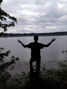 Bryson is in silhouette at Frye Cove Park in Olympia in April 2015, a month before he was shot and paralyzed. Crystal and her family loved Olympia for its peacefulness and natural beauty.