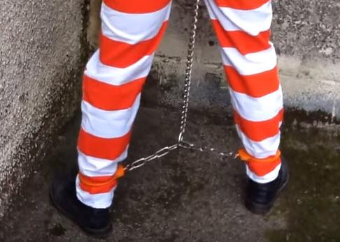 Full restraints, shackled feet