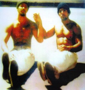 """Two legends of the California Prison Movement, Khatari Gaulden and Hugo """"Yogi"""" Pinell, sit in the sunshine in the San Quentin yard in 1976. – Photo courtesy Kiilu Nyasha"""