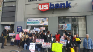 Midtown tenants, neighbors and allies call on US Bank to stop funding developer Mercy California's plan to demolish their apartment complex.