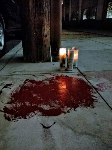 "SFPD took the life of Luis ""Luigi"" Gongora, 45, here on the sidewalk at 18th and Shotwell, where he lived, leaving his blood for the world to see. – Photo: Adriana Camarena"