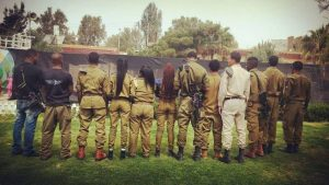 african-Hebrew-soldiers-public-protest-prohibited-turn-backs-to-camera-call-to-refuse-enlistment-300x169, Emigres demand answers after first African American dies during Israeli army service, World News & Views