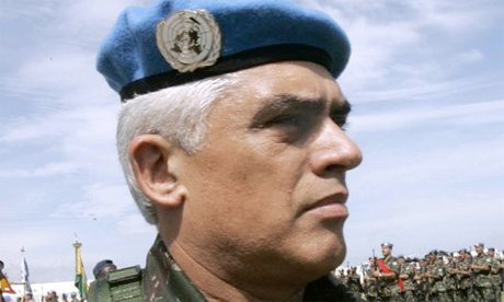 """MINUSTAH commander, Brazilian Army Gen. Urano Teixeira da Matta Bacellar, shown here in Port-au-Prince, Haiti, in 2005, was found shot dead on his balcony there in January 2006, after what his government described first as a """"firearm accident"""" and then as """"suicide."""" Bacellar had earlier resisted calls to use his U.N. peacekeeping force to crack down on pro-Aristide rebels. – Photo: Ariana Cubillos, AP"""
