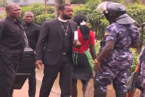 Pastor Happy Ngoga faces arrest as he arrives at FDC headquarters to lead prayers on May 3, 2016.