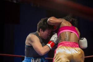 Raquel Miller's right upper cut to Sara Flores' jaw is what set the stage for other combinations of punches that stopped her cold. – Photo: Malaika H Kambon